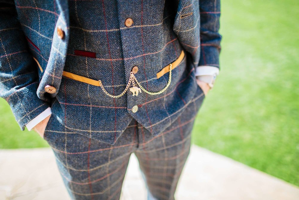 Detail of the grooms suit on his wedding day
