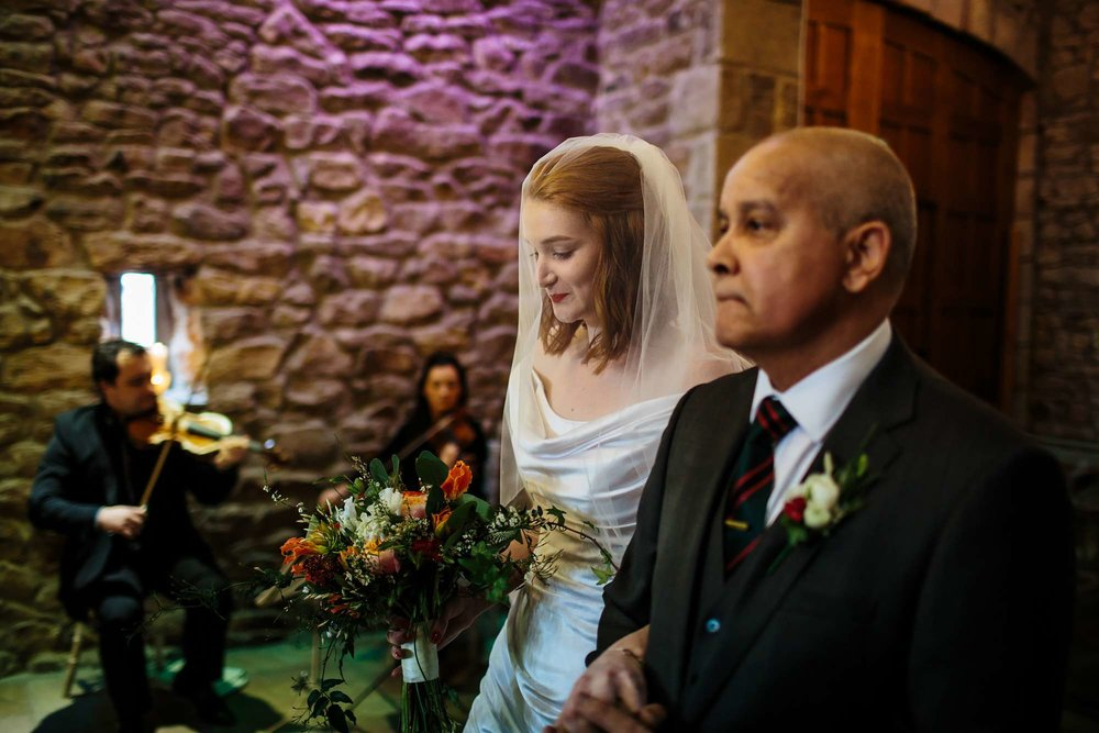 Father of the bride on his daughters wedding day at the service