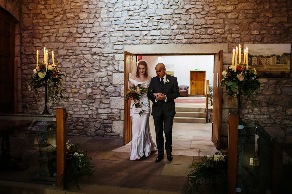 Bride and her father walk down the aisle at Browsholme Hall Wedding