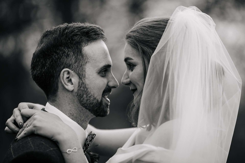 Black and white portrait of the bride and groom at their wedding