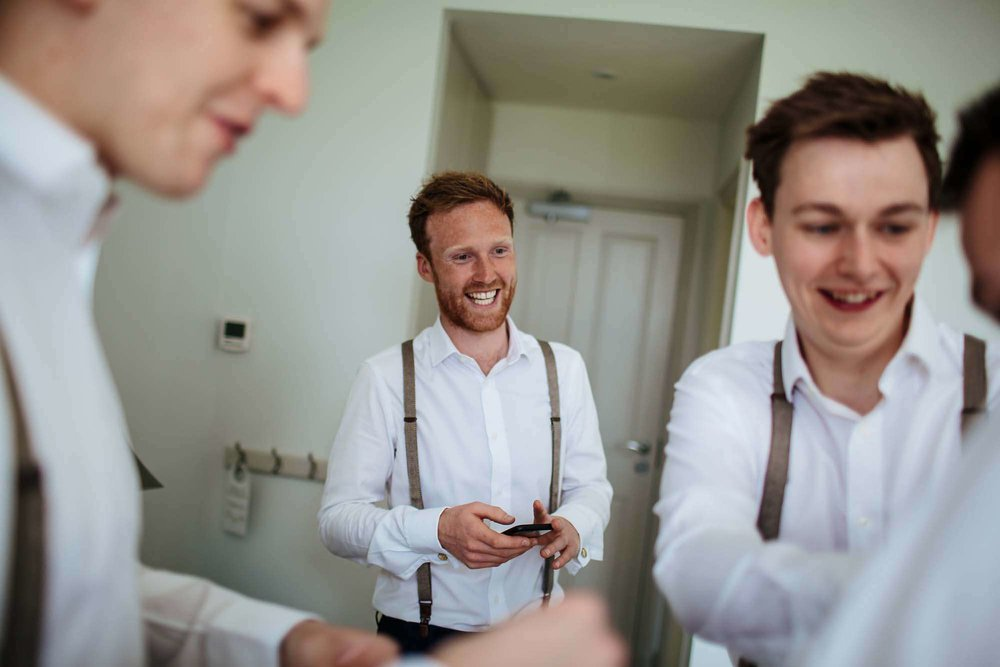Groom getting ready in the Lake District