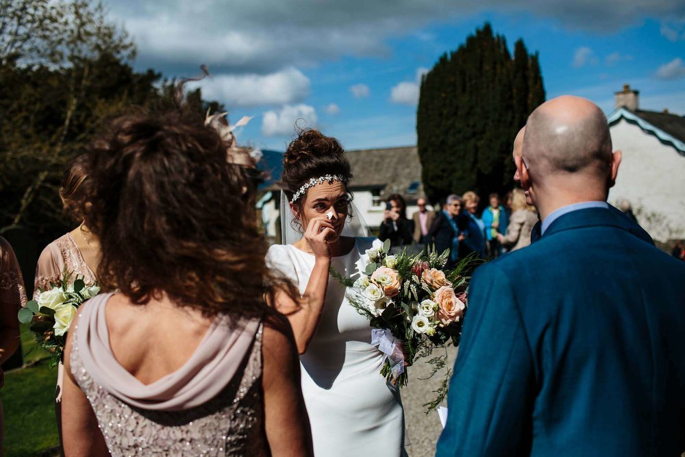 Bride cries before she enters the church