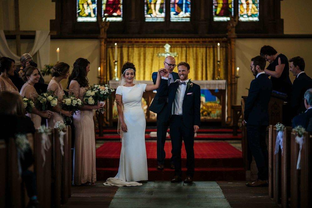 Bride and groom celebrate their church wedding