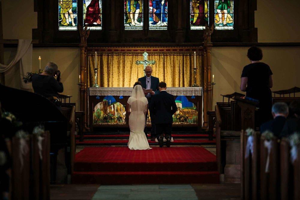 Prayers at a church wedding in Keswick