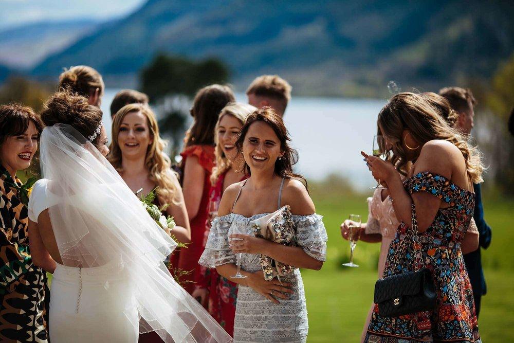 Wedding guests socialising at Armathwaite Hall