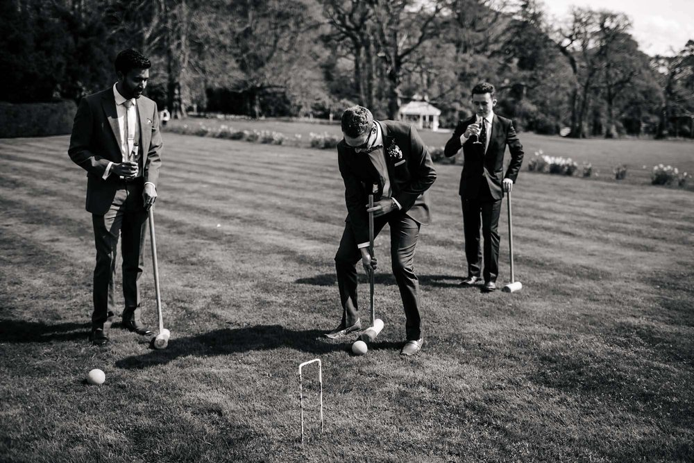 Wedding guests playing croquet at Armathwaite Hall