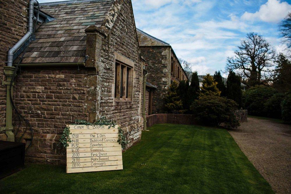 Wedding itinerary sign at Armathwaite Hall