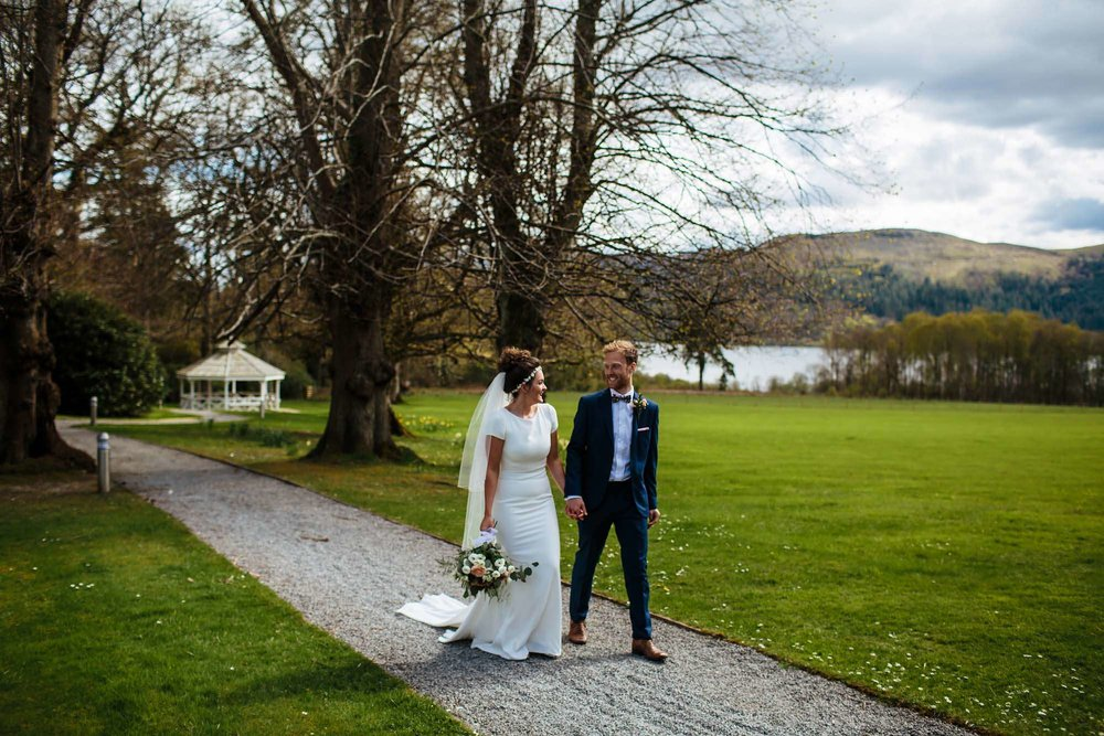 Bride and groom walking in the Lake District