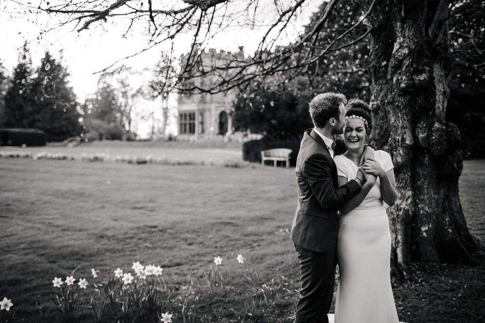 Bride and groom laughing at Armathwaite Hall