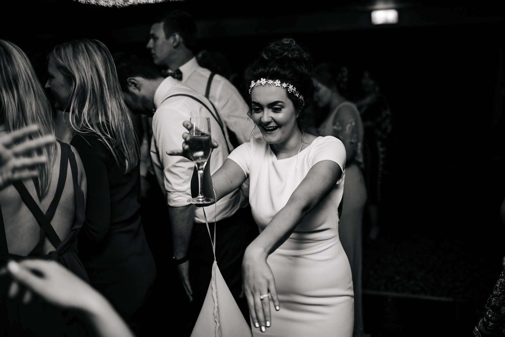 Bride laughing with her guests on the dance floor