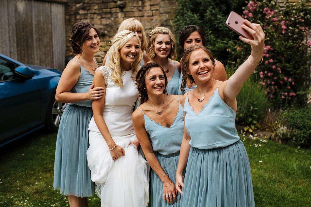 Bridesmaids selfie with the bride at a wedding