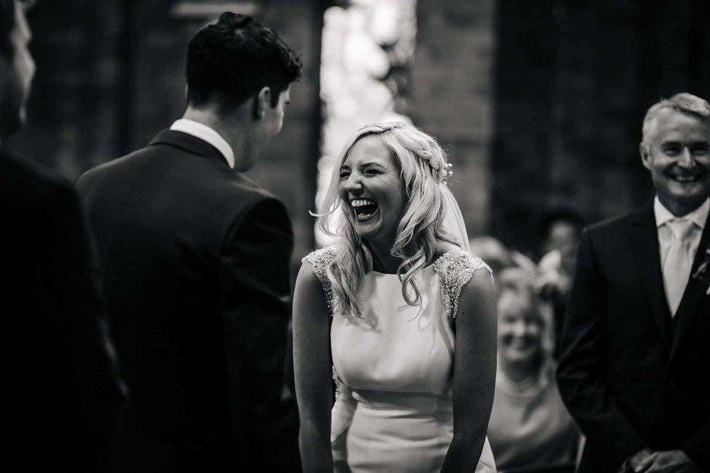Bride laughing at a Leeds church wedding