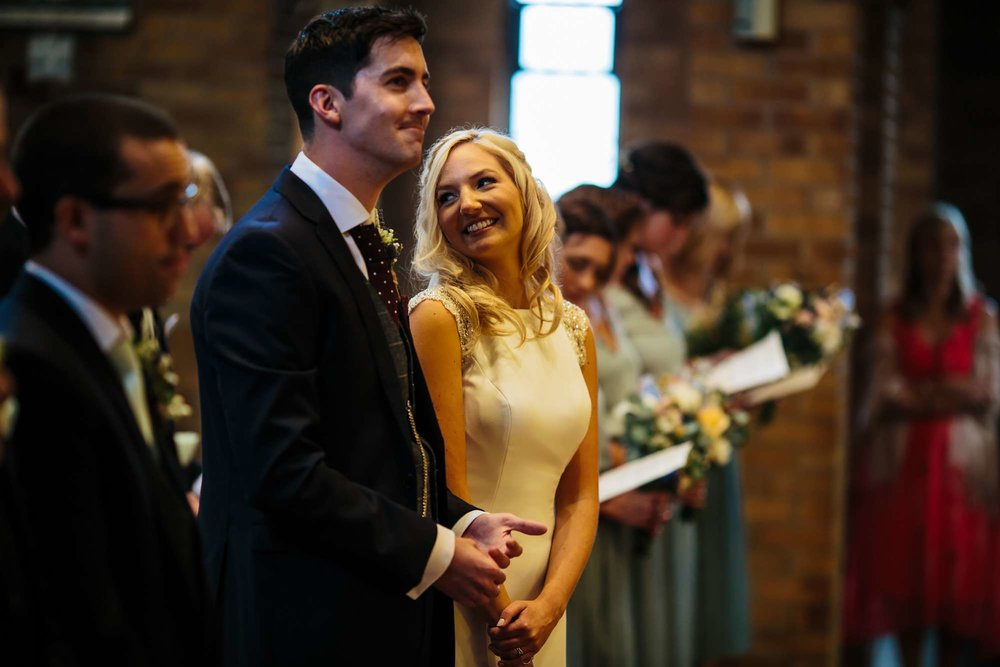 Bride giggling through her wedding ceremony