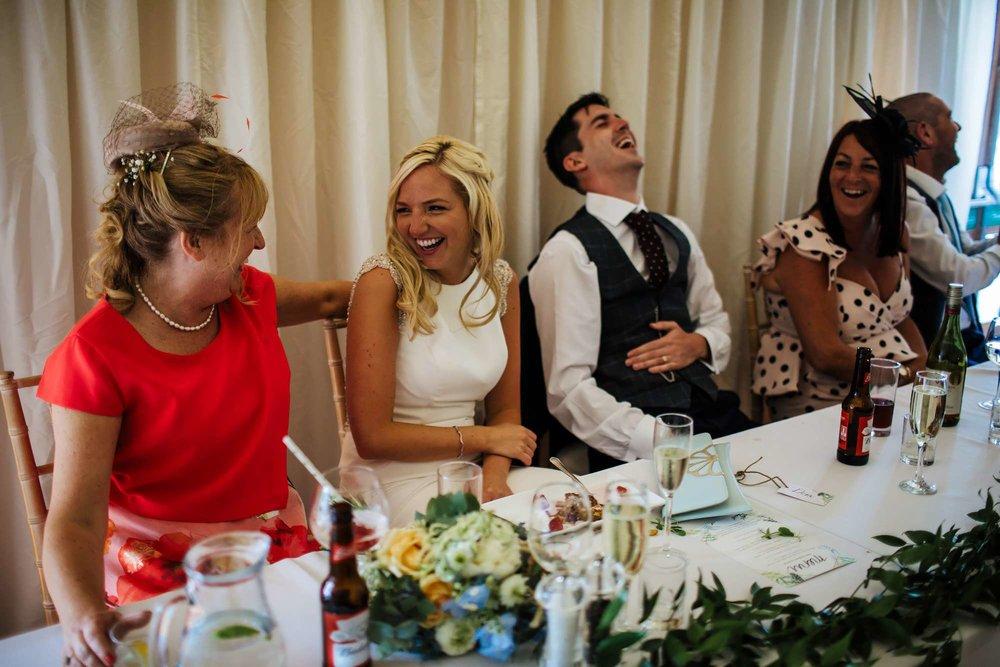 Bride and mum laughing at East Keswick Village Hall wedding