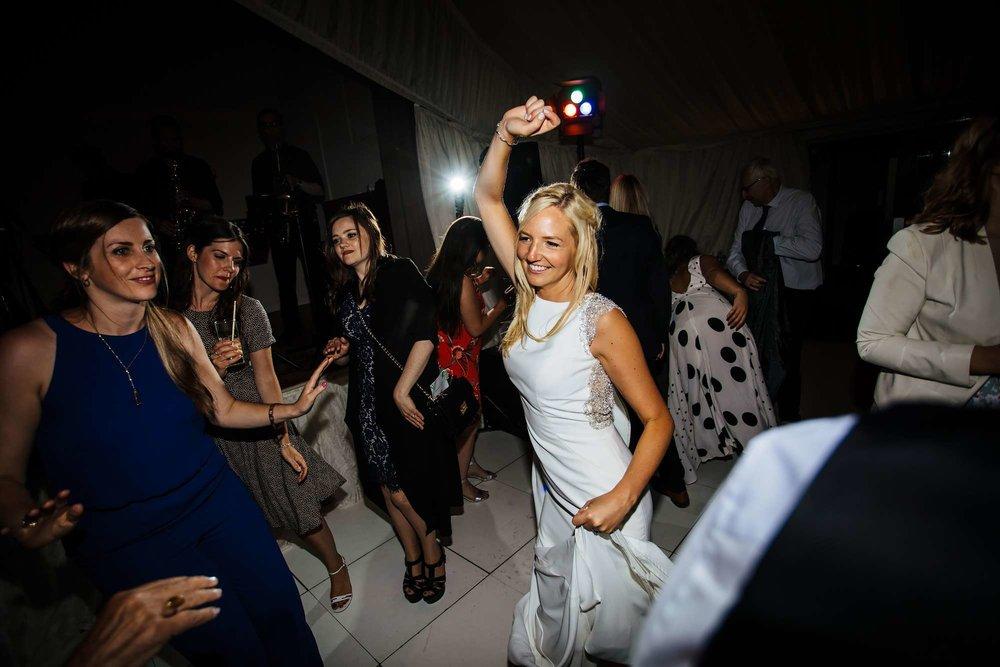 Bride dancing with guests at her Leeds wedding