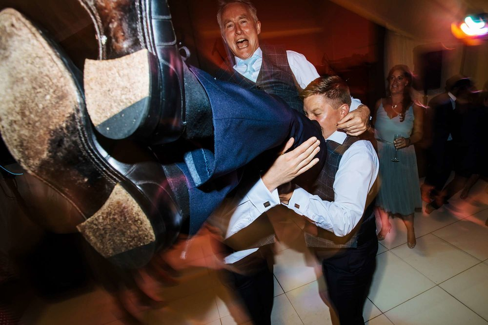 Guests having fun at a wedding on the dance floor