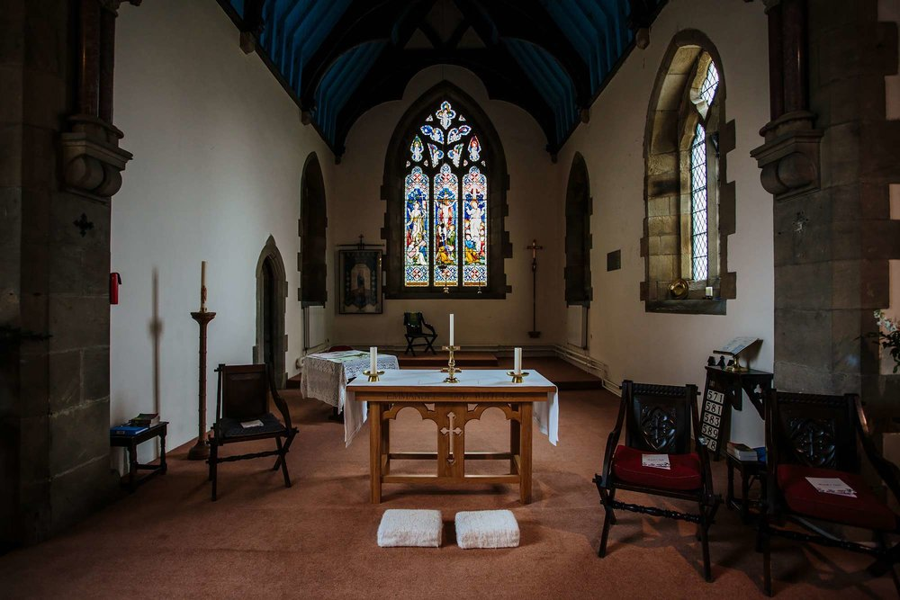 Church alter with stained glass window
