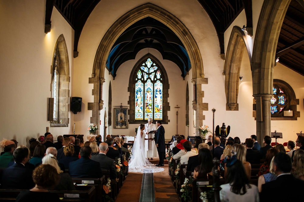 Bride and groom saying I Do in the church