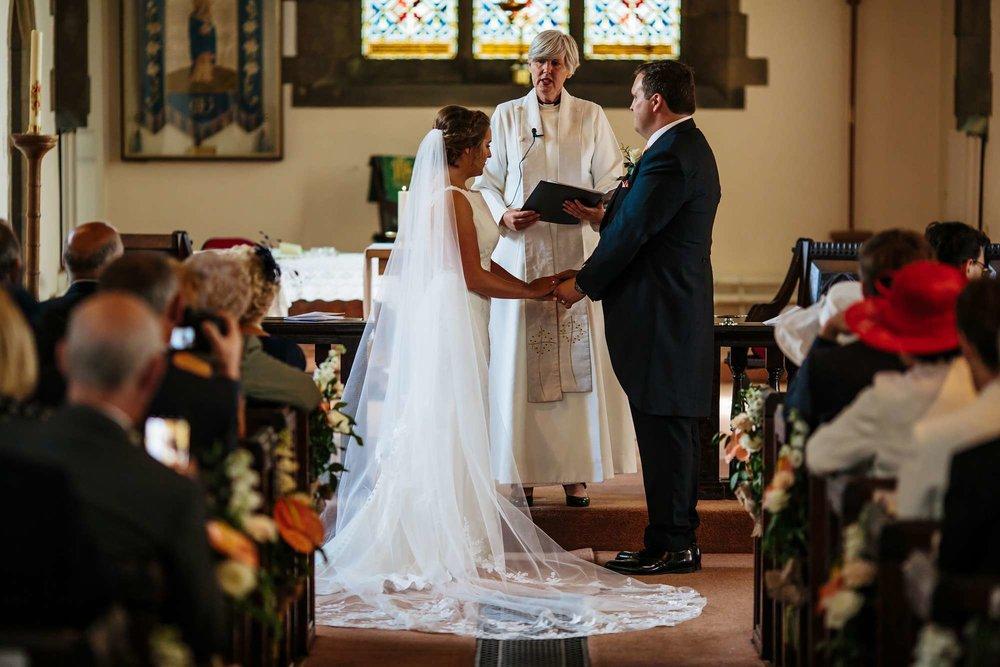 Bride and groom getting married in Huddersfield church
