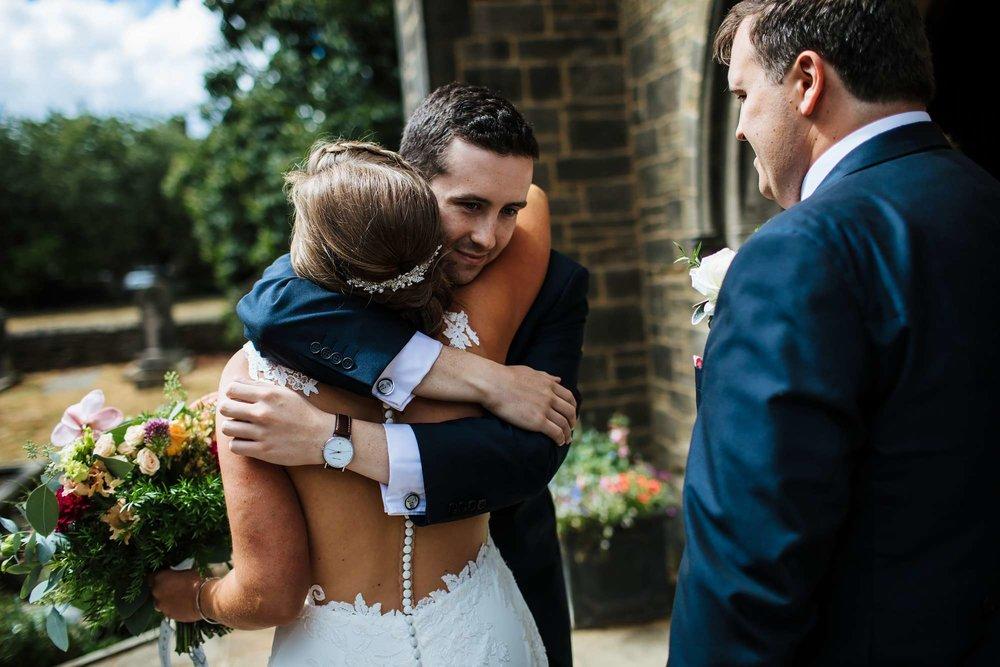 Bride hugging a wedding guest in Huddersfield