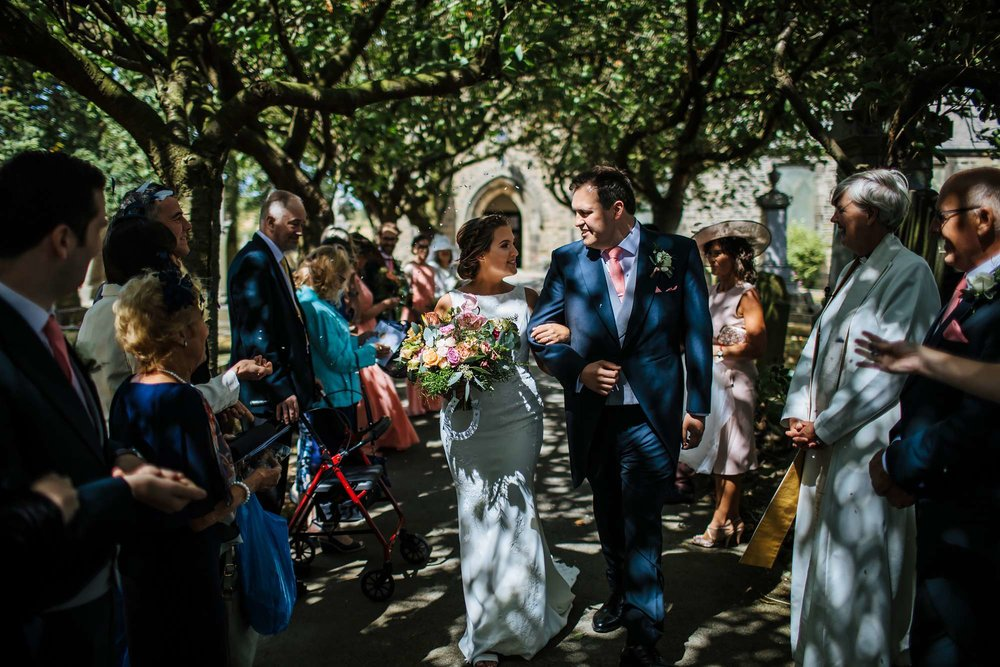 Bride and groom at the church on their wedding day