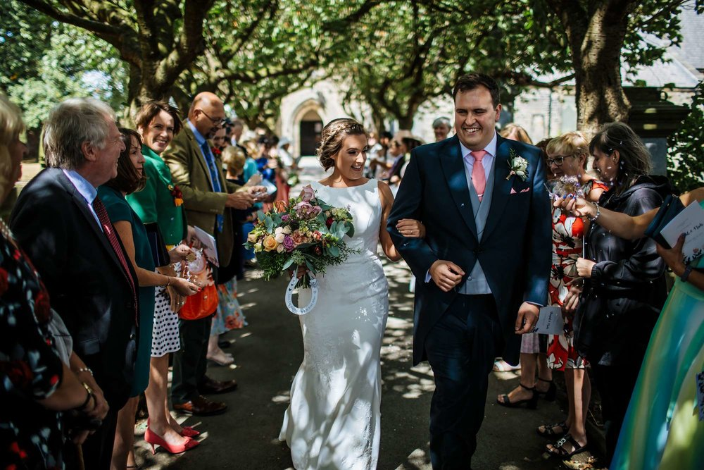 Bride and groom laughing outside the church in Huddersfield