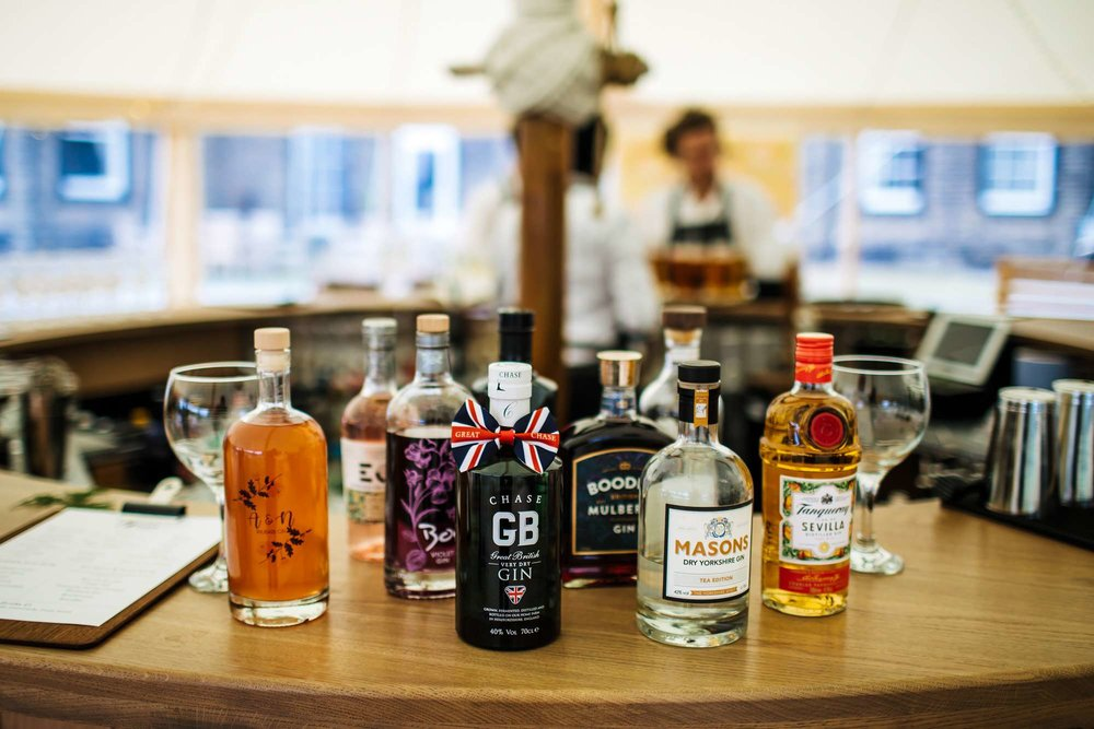 Bottles of gin on the bar at a Fixby Hall wedding