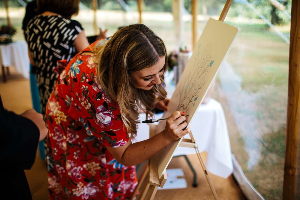 Guests writing on the wedding sign in Yorkshire