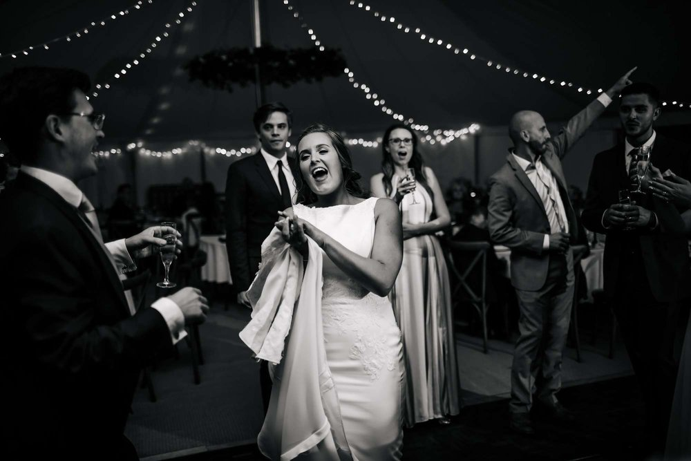 Bride laughing on the dance floor at her wedding