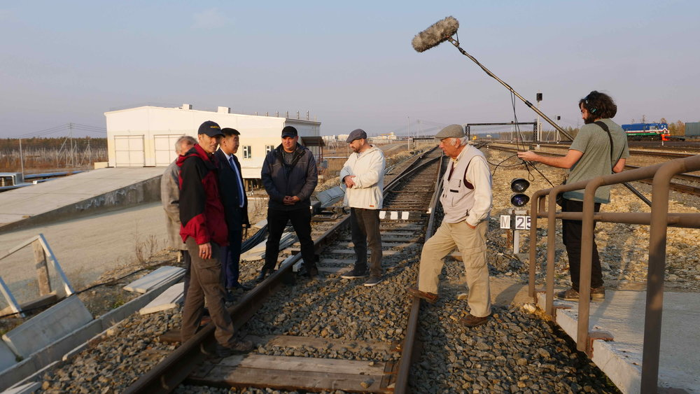 Yakutia Railway's Alexei Mestnikov and Nizny Bestyakh stationmaster Dima Tromin brief the InterContinental Railway team on the particularities of building on permafrost.