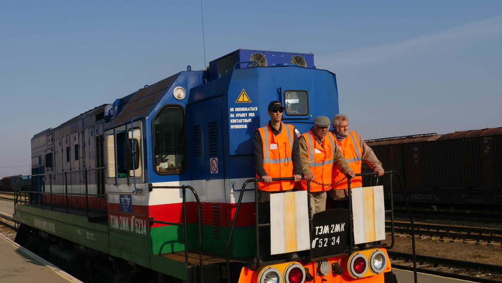InterContinental Railway Chief Project Advisor Scott Spencer and ICR co-founders George Koumal and Victor Razbegin are treated to a ride on a Yakutia Railway locomotive in Nizny Bestyakh.