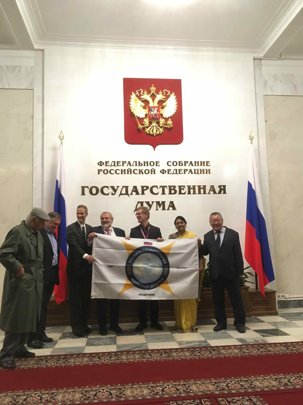 The InterContinental Railway team unveil the Russian version of the ICR flag at the Russian State Duma.