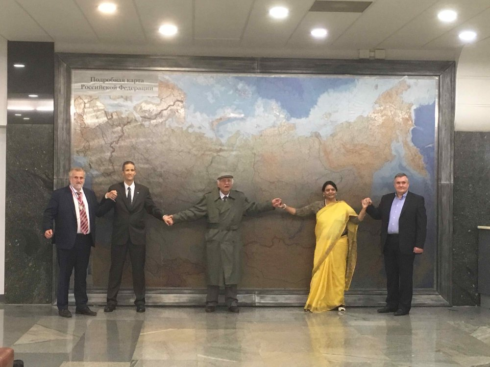The InterContinental Railway team with their new friends in front of a giant map of Russia at the Russian State Duma.