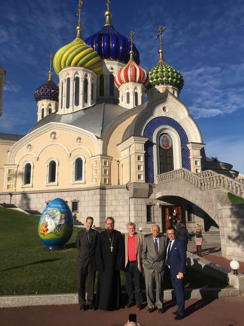 The InterContinental Railway team meet with Father Pimen, a top bishop of the Russian Orthodox Church, at the Patriarch Court to discuss how to gain the church's support for the ICR.
