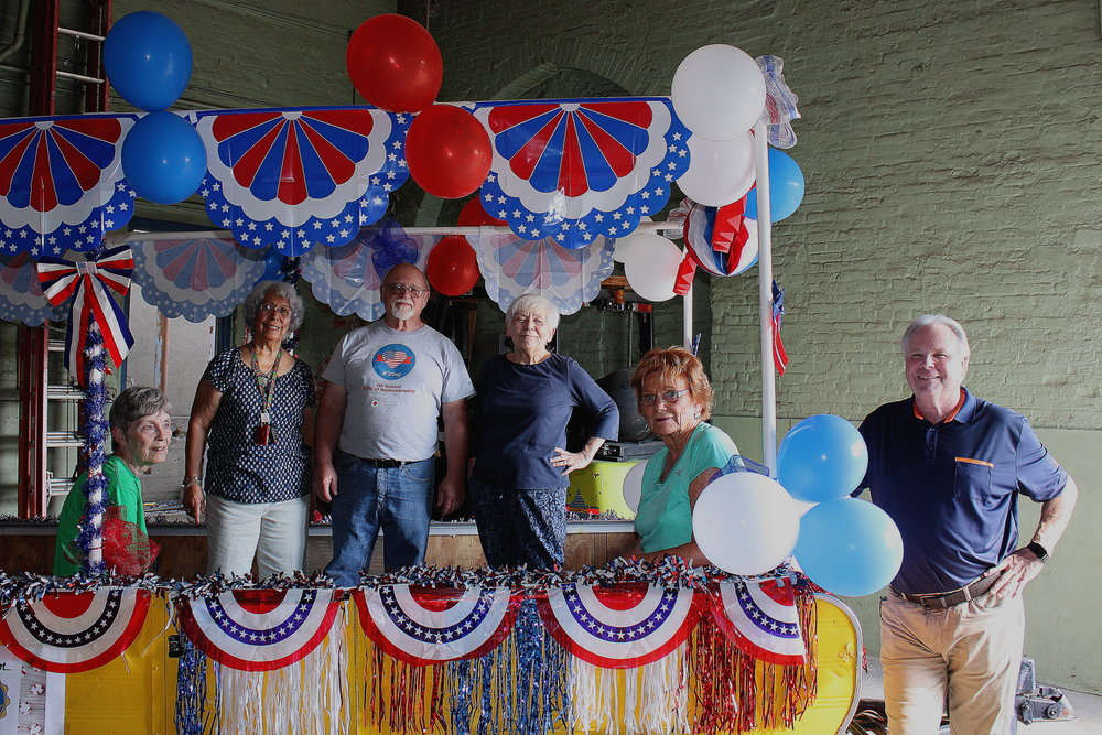 Civitan members prepare the float for the 4th of July Parade.