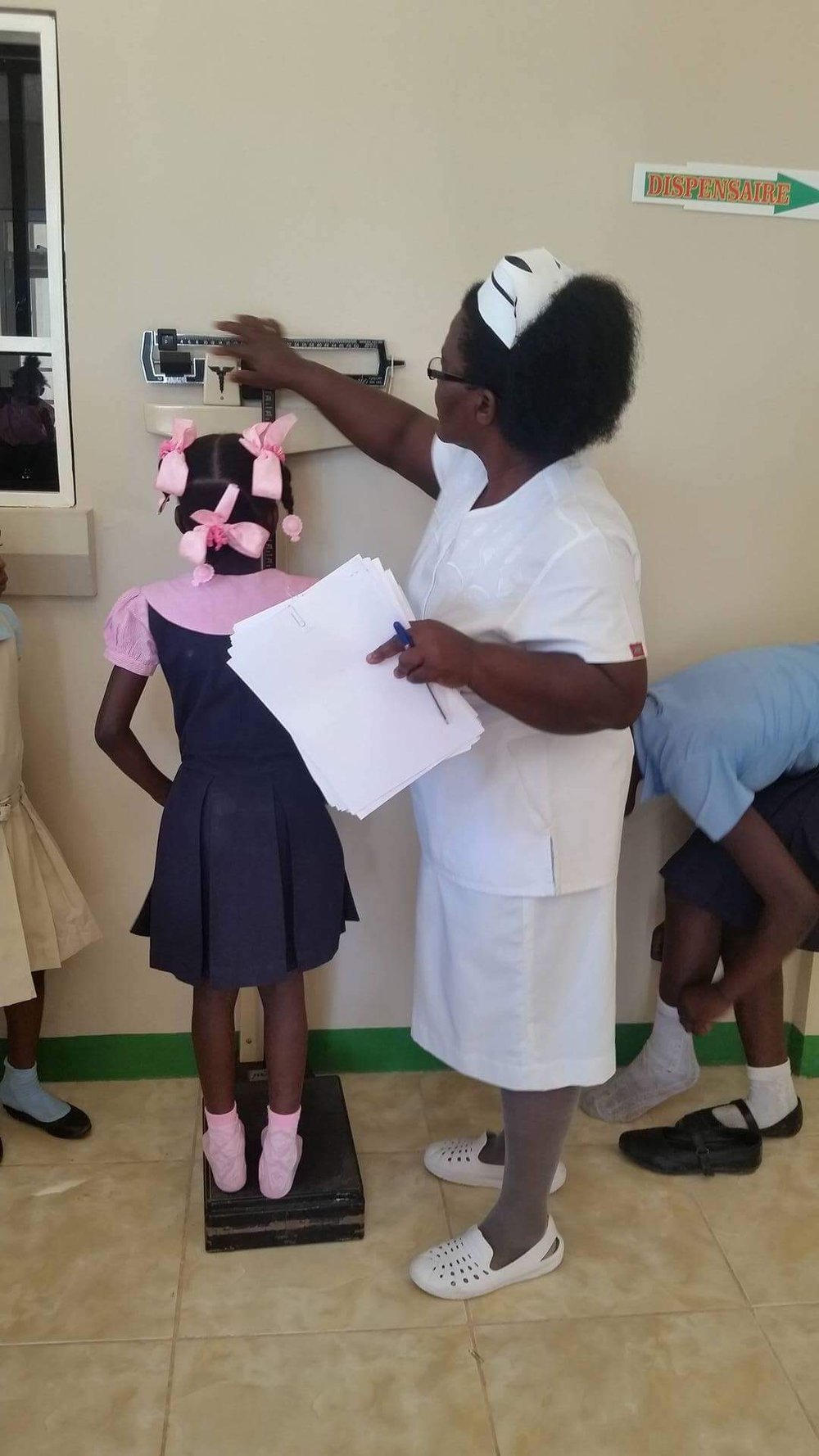 A young girl gets her height and weight measurements taken at the the newly opened CHIDA Hospital in Cap Haitien, Haiti