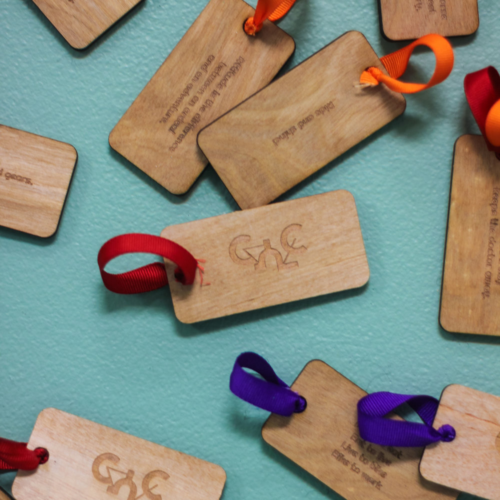 Some of the custom laser-cut tags Sara manufactured
