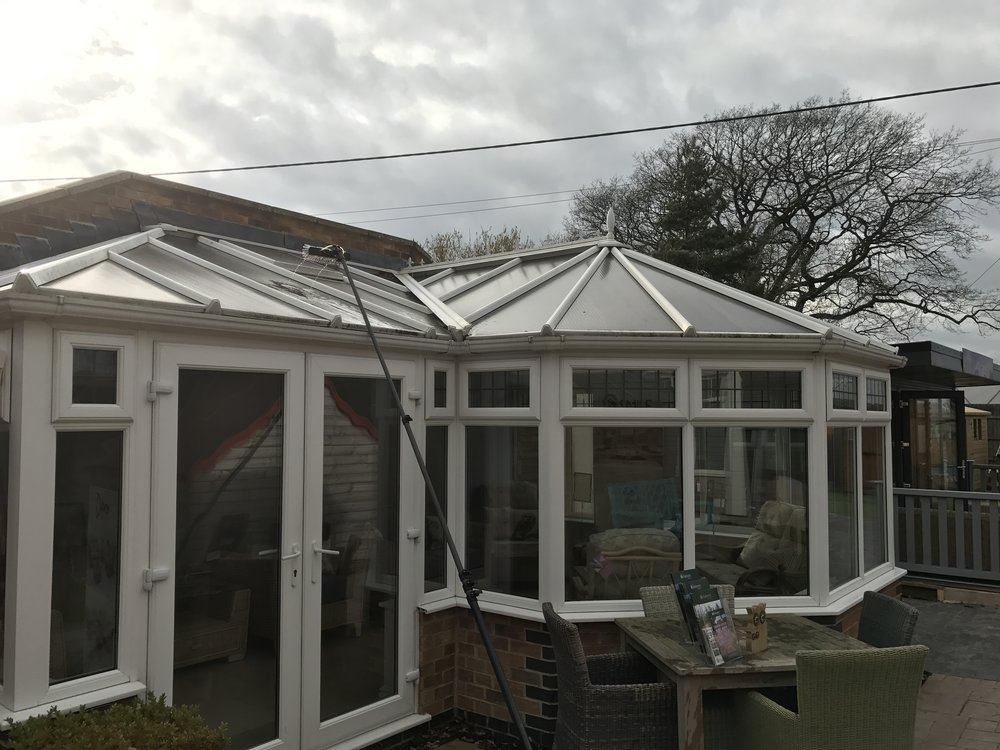 Cleaning roof of conservatory