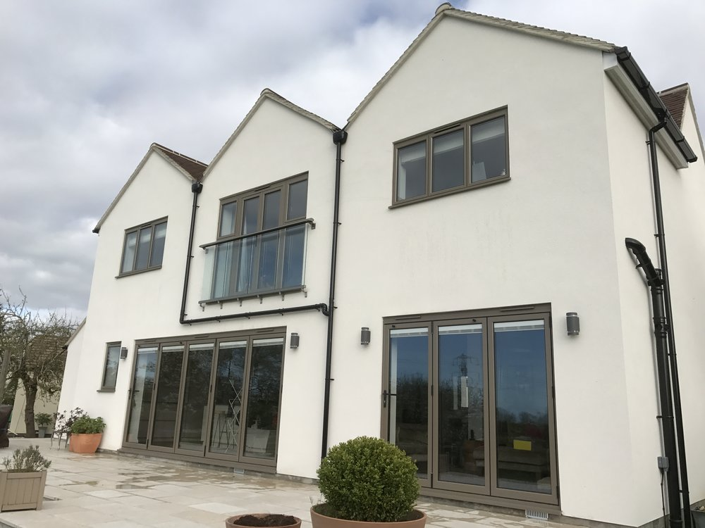 Smart new bi-folding doors and balcony