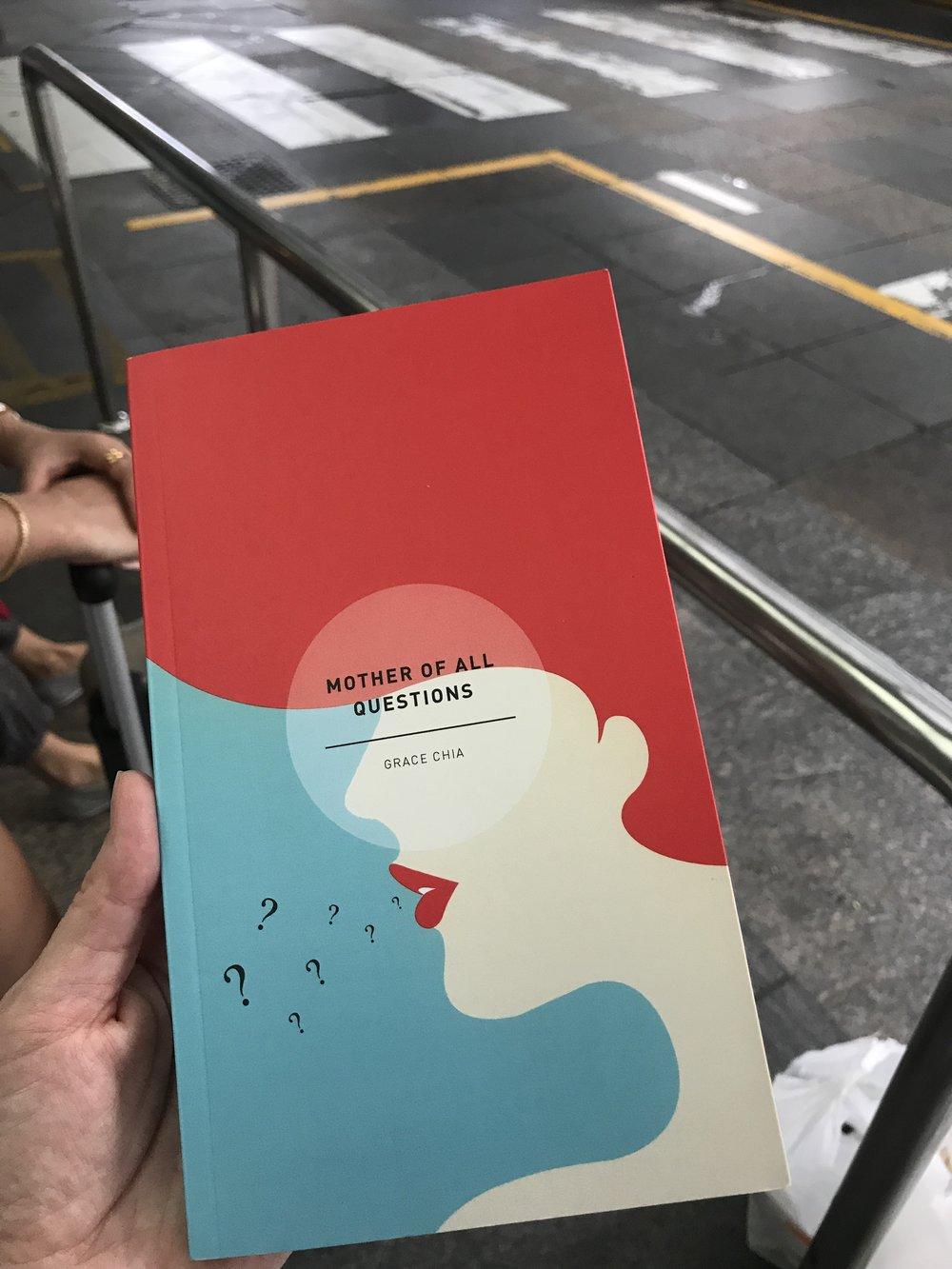 In the taxi queue on the way home - with a copy of my colleague Grace Chia's latest poetry collection