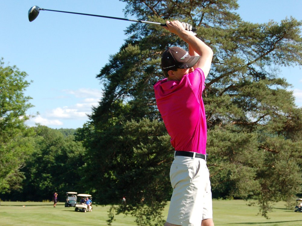 CWE golf participant swinging club