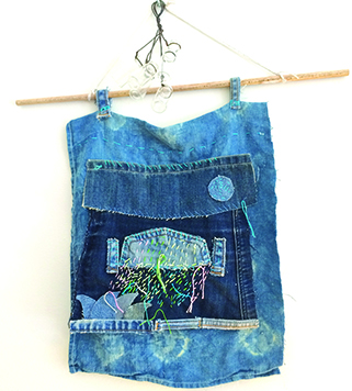 upcycled denim and embroidery wallhanging