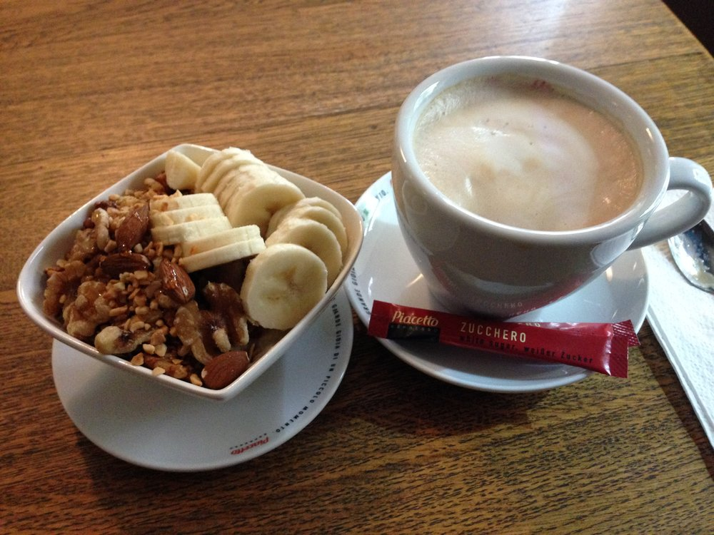 A nut & cluster lovers dream served on top of oatmeal with bananas and honey. Oh, and I cannot forget the cappuccino.