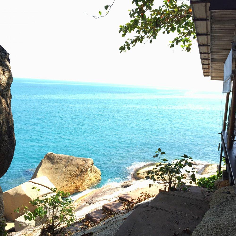 Stairs leading down to ocean rocks.JPG