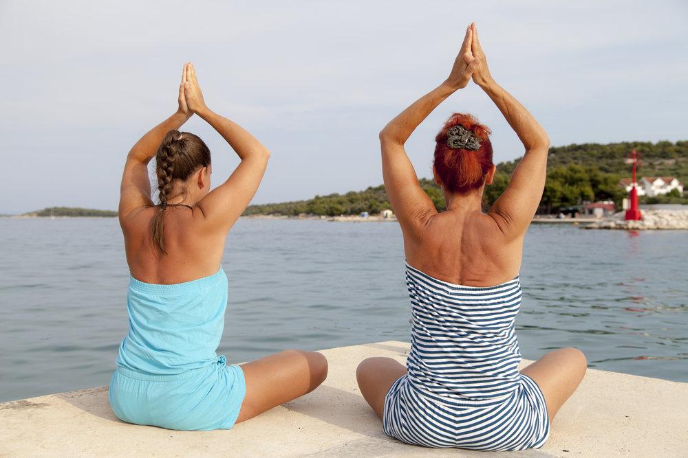 MomDaughter Yoga Prayer Hands.jpeg