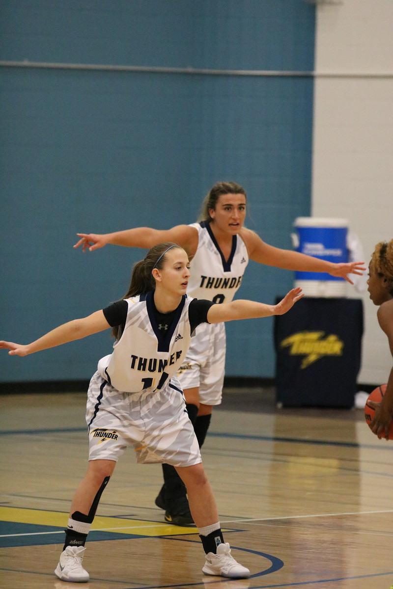 Coaches Sofia Lucadello and Shy Walters paying defence for Concordia University.