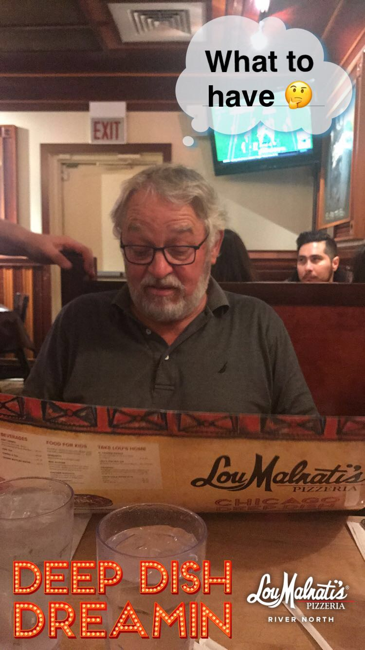 My dad looking over the menu at Lou Malnati's.