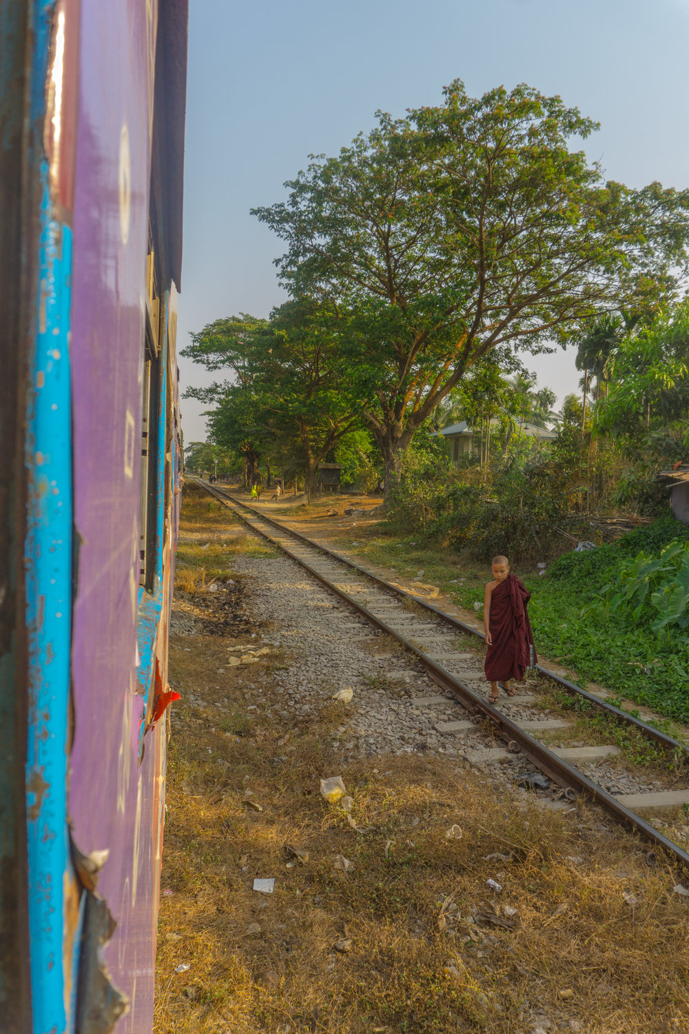 Monk walking alongside Yangon Circular Rail