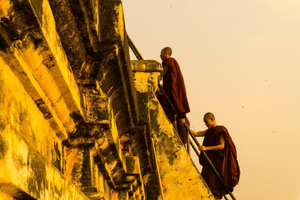 Monks climbing up a pagoda