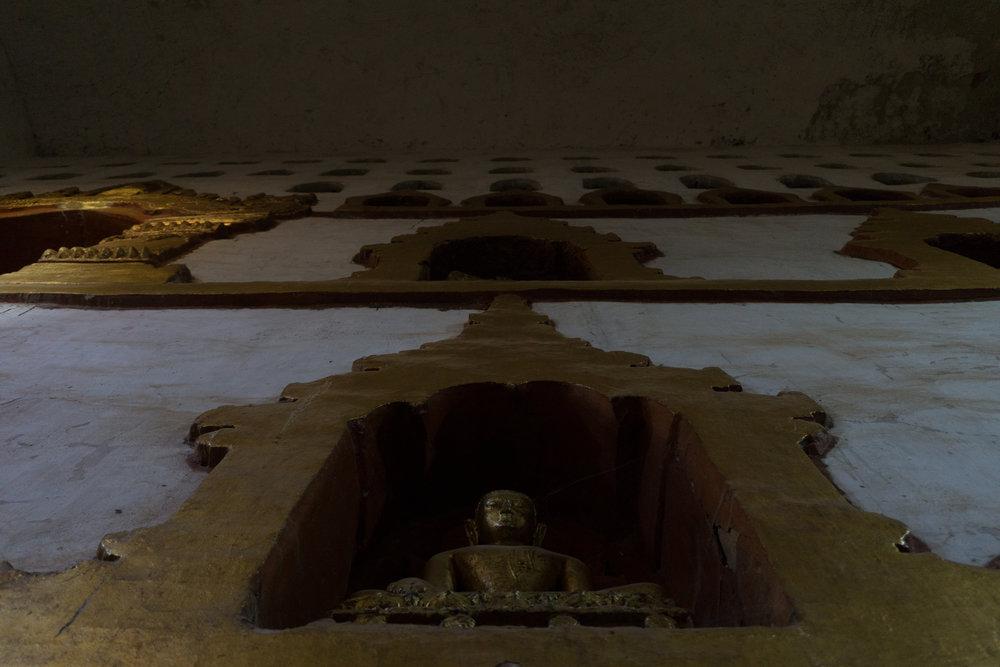 Buddha inside the walls of a pagoda